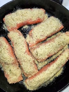 salmon fish uncooked with Parmesan cheese