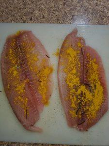 uncooked seasoned tilapia