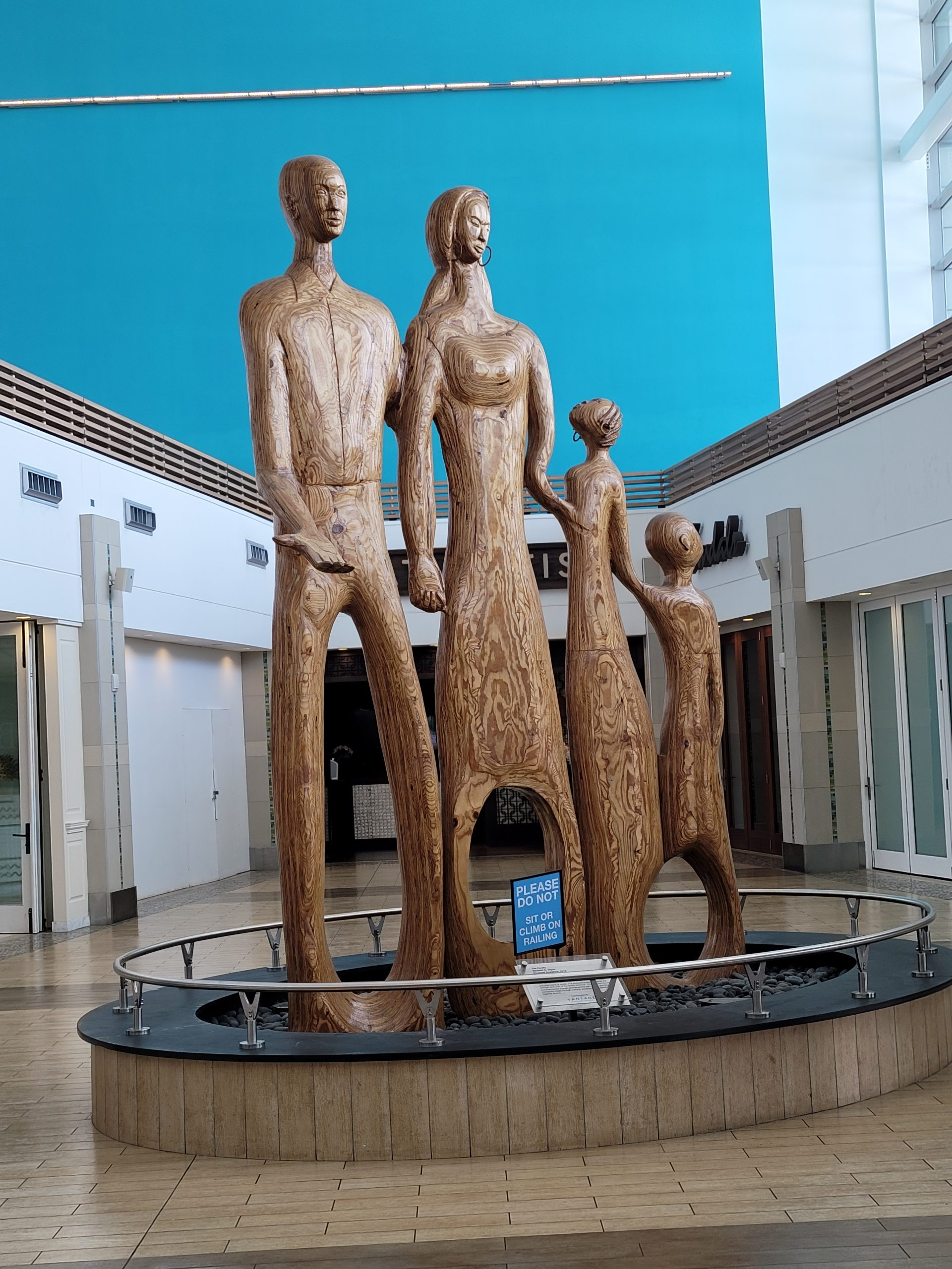 The Family wooden sculptor by Maxwell Taylor: represents the Bahamian family